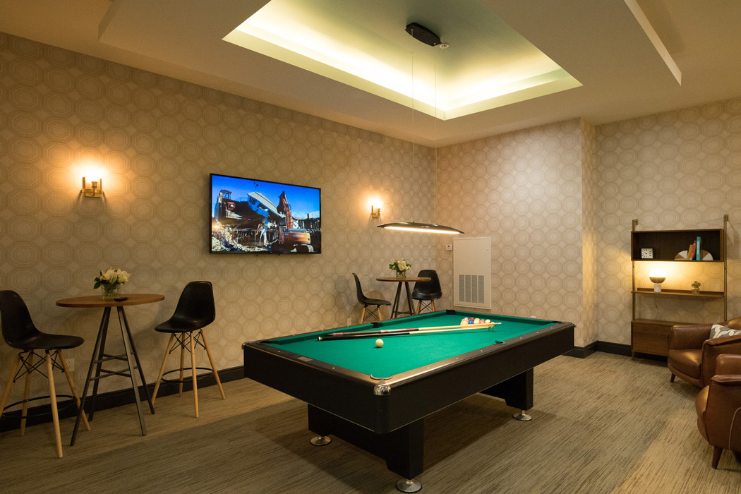Pool table and TV in game room at MKT apartments in Wilmington