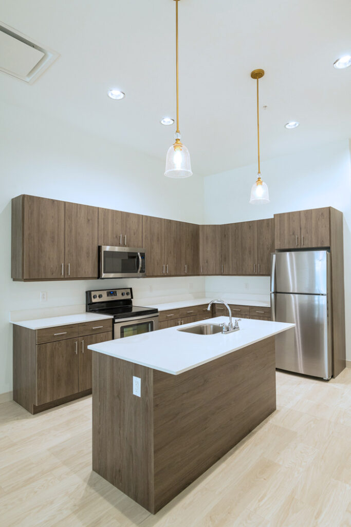 Kitchen in Downtown Wilmington, DE apartments with wooden cabinets and stainless steel appliances