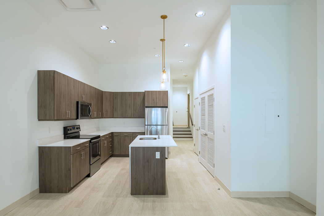 Large kitchen with stainless steel appliances and island at ResideMKT
