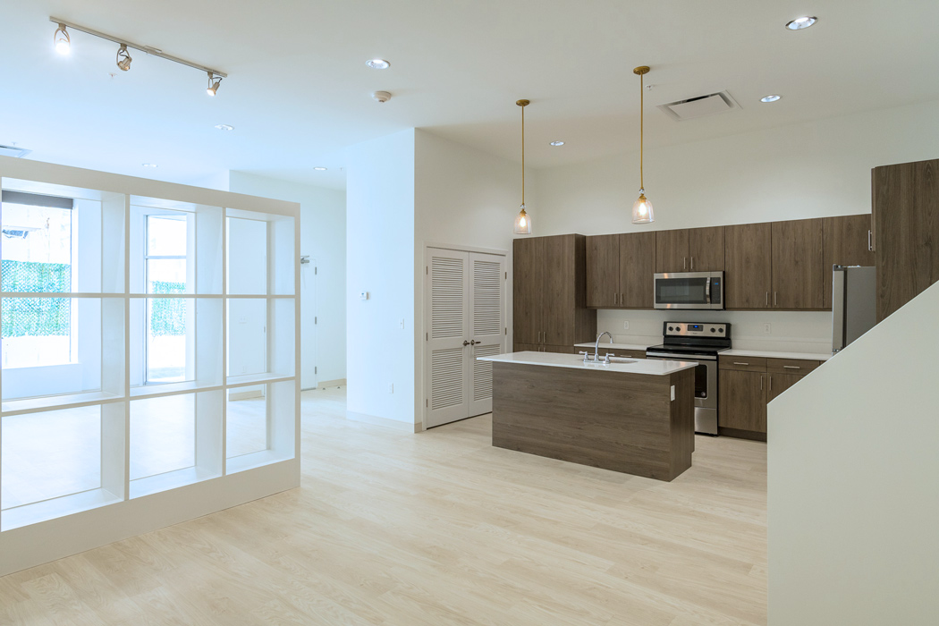 Spacious kitchen with natural light and stainless steel appliances in Wilmington apartment