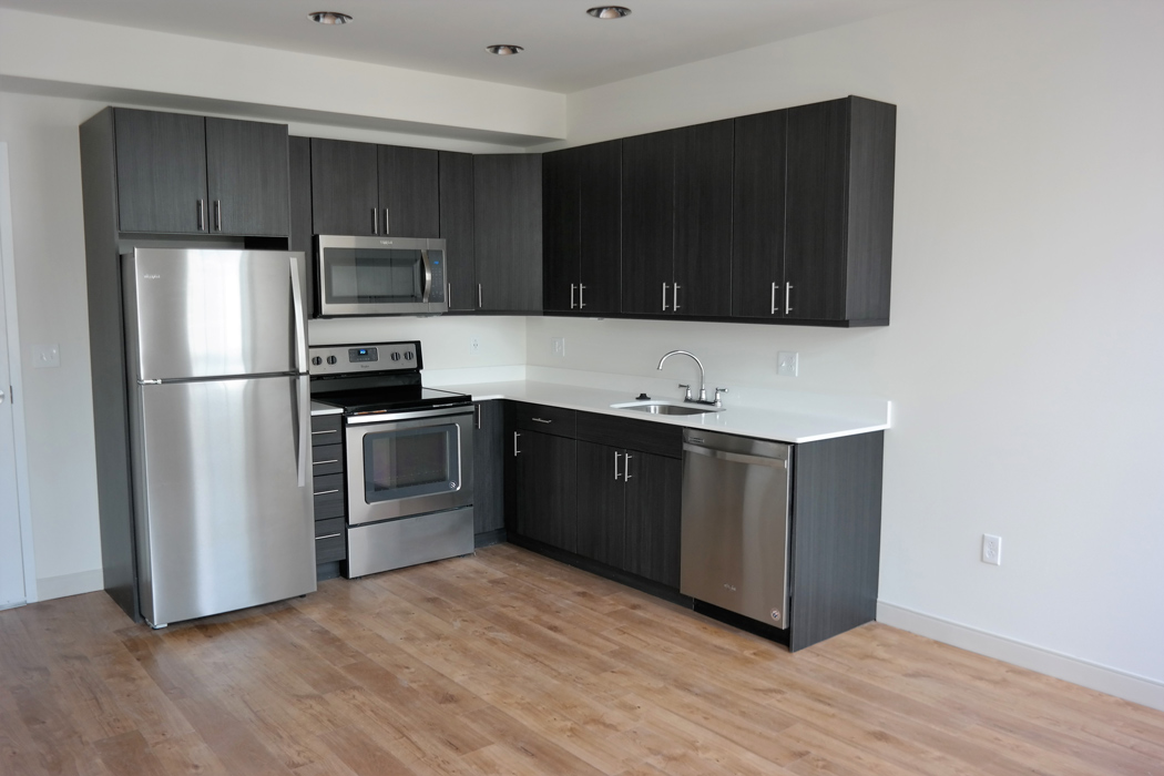 MKTPlace apartments spacious kitchen with stainless steel appliances