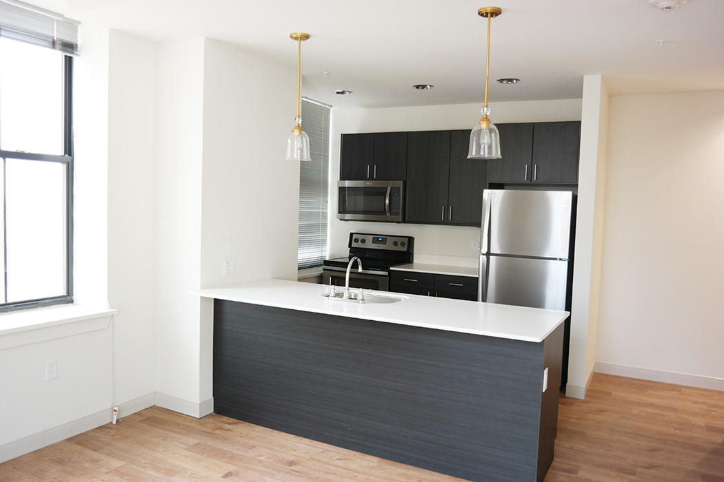 MKT Place spacious kitchen with stainless steel appliances