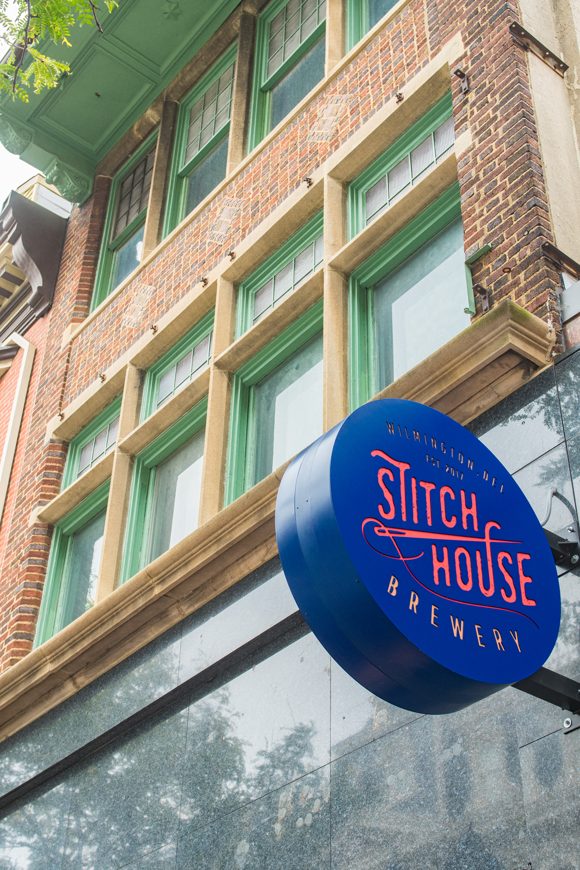 829 MKt apartment exterior with Stitch House Brewery sign